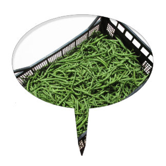 Green beans in box on white background cake toppers