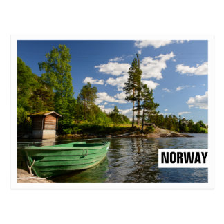 Green boat in a fjord in Norway frame postcard