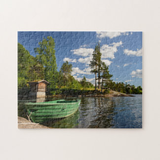 Green boat in a fjord in Norway jigsaw puzzle