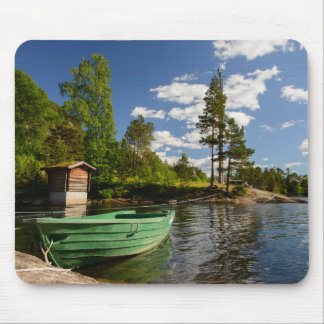 Green boat in a fjord in Norway mousepad