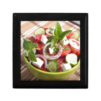 Green bowl with tasty and wholesome vegetarian gift box