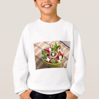 Green bowl with tasty and wholesome vegetarian sweatshirt