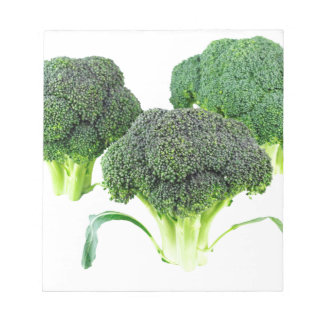 Green Broccoli Crowns on White Notepad