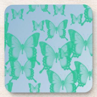 green butterflies in blue background beverage coaster