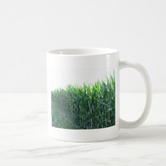 Green corn field on summer day coffee mug