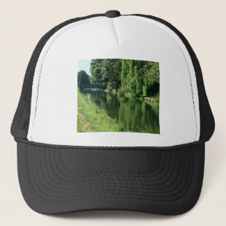Green countryside on a beautiful sunny day. trucker hat