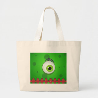 Green cyclops monster with a huge eye large tote bag