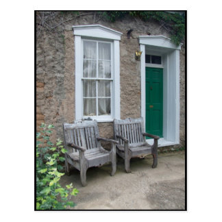 Green Door with Weathered Benches Postcard