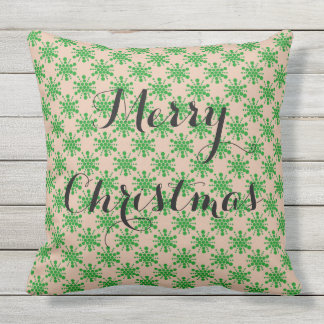 Green dotted star on taupe cushion
