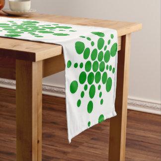 Green dotted stars on white short table runner