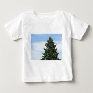 Green fir tree against a clear sky baby T-Shirt