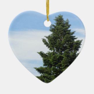 Green fir tree against a clear sky ceramic ornament