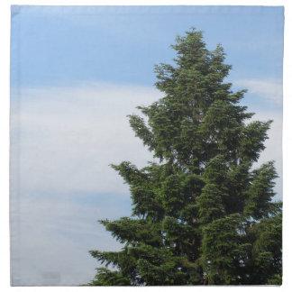 Green fir tree against a clear sky napkin
