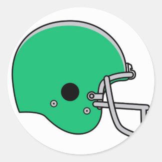 Green football helmet round sticker