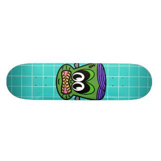 Green Frankenstein monkey on blue tile Skateboard Deck