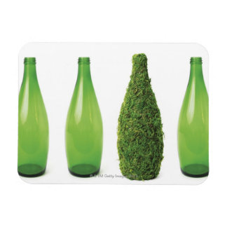 Green glass bottles showing recycling and rectangle magnets