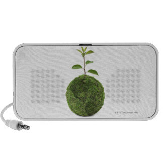 Green globe and seedling showing conservation mini speakers