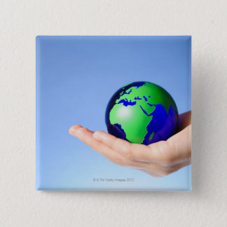 Green globe in hand 15 cm square badge