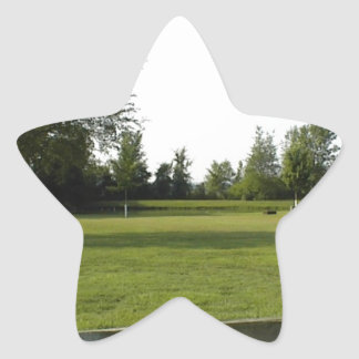 Green Lawn with Wood Fence and Trees Star Sticker