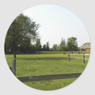 Green Lawn with Wood Fence and Trees Round Sticker