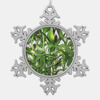 Green leaves and bamboo shoots house plant pewter snowflake decoration