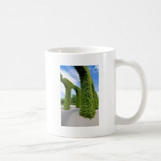 Green leaves arches coffee mug