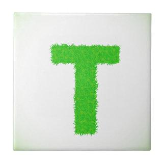green letter ceramic tile