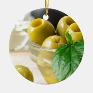 Green marinated olives pitted adorned with green ceramic ornament