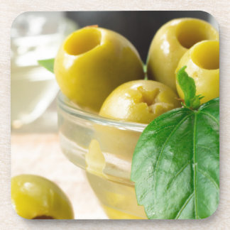 Green marinated olives pitted adorned with green coaster