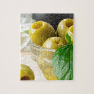 Green marinated olives pitted adorned with green jigsaw puzzle