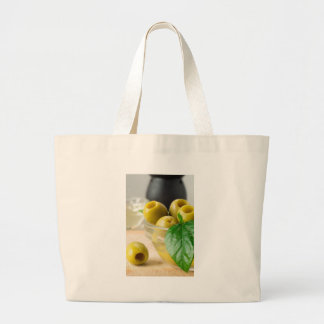 Green marinated olives pitted adorned with green large tote bag