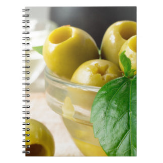 Green marinated olives pitted adorned with green notebook