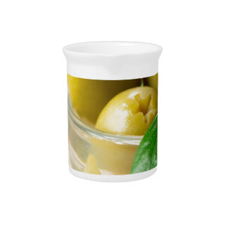 Green marinated olives pitted adorned with green pitcher