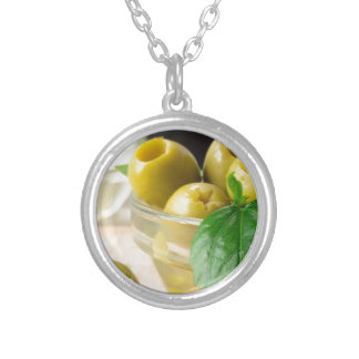 Green marinated olives pitted adorned with green silver plated necklace