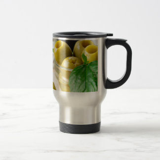 Green marinated olives pitted adorned with green travel mug