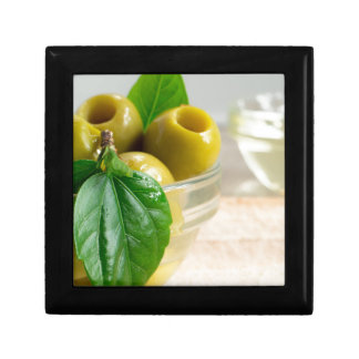 Green marinated olives pitted in a glass cup gift box