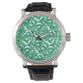 Green monstera tropical leaves pattern  on white b watch