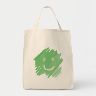 green paint smiley face grocery tote bag