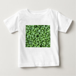 Green pea background . Texture of ripe green peas Baby T-Shirt