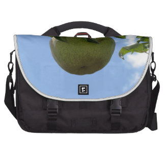 Green pears on tree branches computer bag