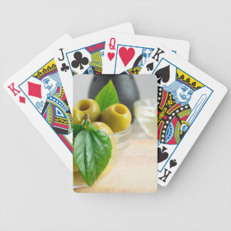 Green pickled pitted olives closeup bicycle playing cards