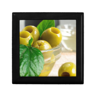 Green pickled pitted olives in a glass bowl gift box