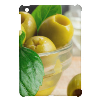 Green pickled pitted olives in a glass bowl iPad mini case