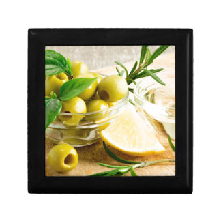 Green pitted olives decorated with herbs gift box