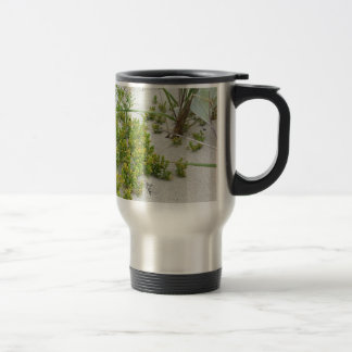 Green plants at the beach travel mug