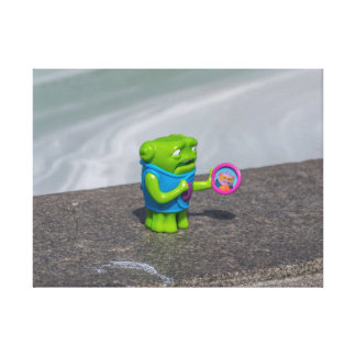 Green plastic toy canvas print