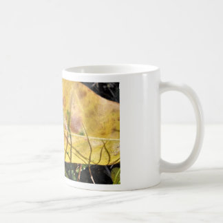 Green speckled yellow leaf in grass basic white mug
