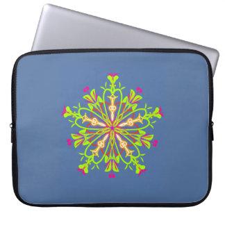 Green starflower mandala on calming blue laptop sleeve