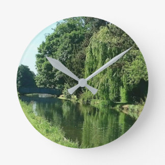 Green sunny spring day green trees river walk round clock