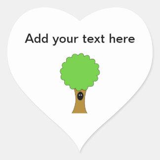 Green tree cartoon with creature. heart sticker